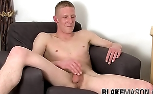 Good looking young dude grabs his dick and masturbates solo