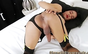 Shemale cums on her mask