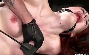 Blindfolded in metal device redhead toyed