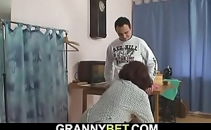 70 years old woman enjoys riding his young cock