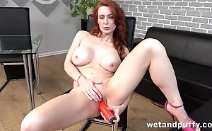 Luxurious red-haired MILF stuffs cunny with red trinket