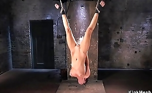 Tied up brunette anal fisted close to dungeon